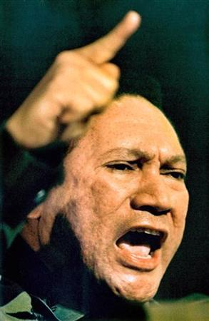 Manuel Noriega gestures while giving a speech in Panama City in this March 1988 file photo. REUTERS/Gary Hershorn/Files
