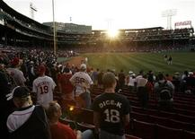 <p>Fans arrive for MLB's 2010 season opener to watch the reigning World Series Champions New York Yankees take on the Boston Red Sox in their American League baseball game at Fenway Park in Boston, Massachusetts in this April 4, 2010 file photo. REUTERS/Adam Hunger</p>
