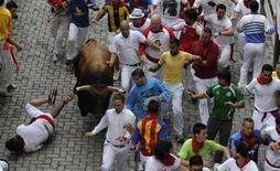 <p>A runner falls in front of a Fuente Ymbro fighting bull at the entrance to the bullring during the third running of the bulls on the fourth day of the San Fermin festival in Pamplona July 9, 2010. Three people needed hospital treatment following a run that lasted six minutes and twenty three seconds according to local news sources. REUTERS/Eloy Alonso</p>