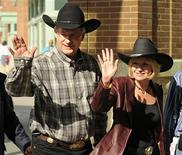 <p>Canada's Prime Minister Stephen Harper and his wife Laureen arrive for the President's Reception during the first day of the rodeo at the Calgary Stampede in Calgary, Alberta, July 9, 2010. REUTERS/Todd Korol</p>