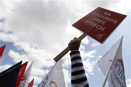 A striker holds a Unite union banner at a rally in Hyde Park, central London May 28, 2010. REUTERS/Stefan Wermuth