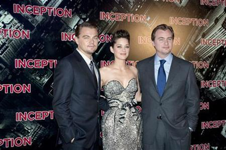 Actors Leonardo DiCaprio (L), Marion Cotillard (C) and director Christopher Nolan pose as they arrive for the premiere of the film ''Inception'' in Paris July 10, 2010. REUTERS/Gonzalo Fuentes