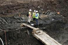 <p>Archaeologists examine the remnants of a centuries old wooden ship at the World Trade Center site in lower Manhattan, July 15, 2010. REUTERS/Lucas Jackson</p>