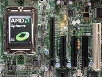 <p>A new AMD Opteron 6000 series processor is seen on a motherboard during a product launch in Taipei April 14, 2010. REUTERS/Pichi Chuang (TAIWAN)</p>