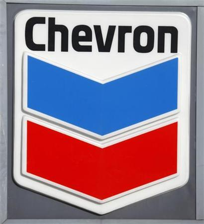 The Chevron corporate logo is displayed at a Washington D.C. gas station January 11, 2010. Chevron's quarterly results are to be released on Monday. REUTERS/Jason Reed