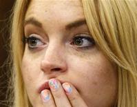 <p>Lindsay Lohan em tribunal antes de ouvir sua sentença de 90 dias na prisão em Beverly Hillsy. Lohan teria se mudado para uma clínica de vida sóbria menos de uma semana antes da começar a cumprir pena. 06/07/2010 REUTERS/David McNew/Pool</p>