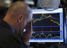 <p>A trader reacts to the monitor shortly before the closing bell as he works on the floor of the New York Stock Exchange in New York June 4, 2010. REUTERS/Jessica Rinaldi</p>