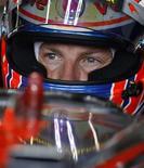 <p>Piloto da McLaren Jenson Button durante treino livre para o Grande Prêmio da Grande Prêmio em Silverstone. O campeão mundial de Fórmula 1 endossou a ideia de um Grande Prêmio na Rússia após fazer um teste de corrida ao redor do Kremlin neste domingo. 10/07/2010 REUTERS/Steve Crisp</p>