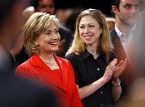 <p>Secretary of State Hillary Clinton is applauded by her daughter Chelsea (R) after arriving at the Clinton Global Initiative in New York September 25, 2009. REUTERS/Chip East</p>