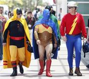 <p>Visitors dressed as DC Comics' (L to R) Hourman, Atom and Flash walk during the 40th annual Comic Con Convention in San Diego in this July 24, 2009 file photo. REUTERS/Mario Anzuoni/Files</p>