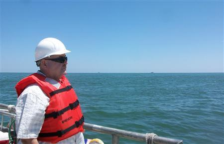 Retired Coast Guard Admiral Thad Allen rides on a crew boat in the Gulf of Mexico on a trip to view ''vessels of opportunity'', private boats that are helping to clean up spilled oil in the Gulf of Mexico, in this July 8, 2010 file photo. REUTERS/Jeff Mason/Files
