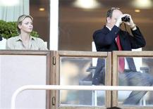 <p>Prince Albert of Monaco and his fiancee Charlene Wittstock attend the Herculis athletics meeting at Louis II stadium in Monaco July 22, 2010. REUTERS/Sebastien Nogier</p>
