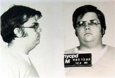 <p>A mug-shot of Mark David Chapman, who shot and killed John Lennon, is displayed on the 25th anniversary of Lennon's death at the NYPD in New York December 8, 2005. REUTERS/Stringer</p>