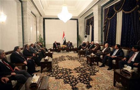 Iraq's Prime Minister Nuri al-Maliki (centre R) meets with Iyad Allawi (centre L), Iraq's former Prime Minister and head of the delegation of the Iraqiya coalition, in Baghdad July 20, 2010. REUTERS/Iraqi Government/Handout