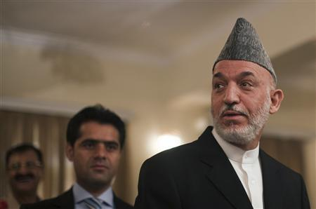 Afghan President Hamid Karzai leaves after a news conference in Kabul July 29, 2010. REUTERS/Ahmad Masood