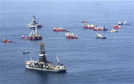 Drill ships and response vessels work in the Gulf of Mexico off the Louisiana coast line while attempting to drill relief wells at the Deepwater Horizon Oil Spill wellhead July 27, 2010. REUTERS/Sean Gardner