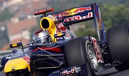 <p>Piloto da Red Bull Sebastian Vettel durante treino livre para o GP da Hungria, próximo de Budapeste. Vettel dominou o treino desta sexta-feira, enquanto Felipe Massa, da Ferrari, foi o quarto mais veloz no circuito. 30/07/2010 REUTERS/Laszlo Balogh</p>