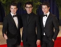 <p>The Jonas Brothers, Kevin, Joe and Nick (L-R) arrive at the White House Correspondents' Association dinner in Washington May 1, 2010. REUTERS/Richard Clement</p>