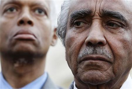 Rep. Charles Rangel (R) stands in front of the media after meeting of the Congessional Black Caucus with President Barack Obama at the White House in Washington, March 11, 2010. From L-R are: Rep. Hank Johnson and Rangel. REUTERS/Larry Downing