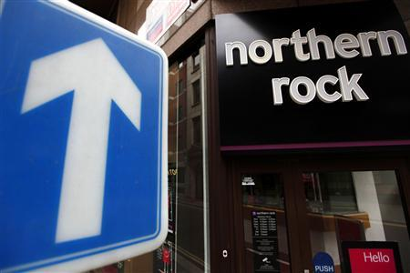 A one way street sign is seen outside a branch of Northern Rock in the City of London, Augsut 3, 2010. REUTERS/Andrew Winning
