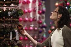 <p>A customer browses in Selfridges' Christmas shop as it opens for business 145 days ahead of Christmas Day in central London, August 2, 2010. REUTERS/Andrew Winning</p>