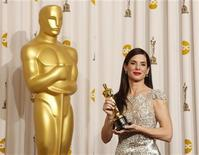 "<p>Best actress winner Sandra Bullock for the film ""The Blind Side,"" displays her Oscar at the 82nd Academy Awards in Hollywood March 7, 2010. REUTERS/Lucy Nicholson</p>"