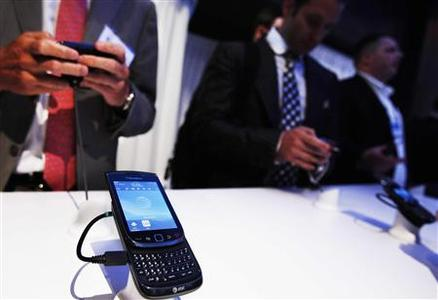 People test the new BlackBerry Torch 9800 smartphone after it was introduced at a news conference in New York August 3, 2010. REUTERS/Shannon Stapleton