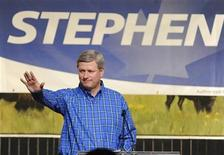 <p>Canada's Prime Minister Stephen Harper gestures as he speaks at the annual BBQ dinner during the Calgary Stampede in Calgary, Alberta, July 10, 2010. REUTERS/Todd Korol</p>