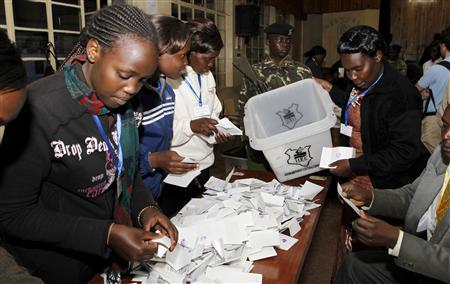 Electoral officials sort out ballots before counting votes at a polling centre in Eldoret town, 300km west of Kenya's capital Nairobi, August 4, 2010. REUTERS/Thomas Mukoya