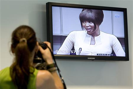 British supermodel Naomi Campbell is seen on a screen in the pressroom of the U.N.-backed Special Court for Sierra Leone in Leidschendam August 5, 2010. REUTERS/Vincent Jannink/Pool