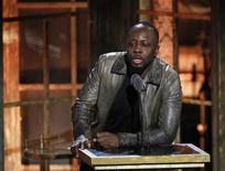 <p>Foto de archivo de la estrella de hip-hop Wyclef Jean durante la presentación del cantante Jimmy Cliff en el Salón de la Fama del Rock& Roll en Nueva York, mar 15 2010. Jean se inscribió el jueves como candidato para las elecciones presidenciales de noviembre en Haití, dijo un miembro de su partido. REUTERS/Lucas Jackson</p>