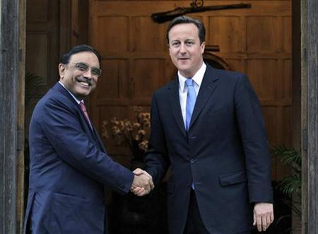 Britain's Prime Minister David Cameron (R) greets Pakistan's President Asif Ali Zardari at Chequers near Princes Risborough in England, August 5, 2010. REUTERS/Kirsty Wigglesworth/Pool
