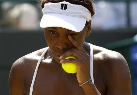 Venus Williams of the U.S. prepares to serve in her match against Bulgaria's Tsvetana Pironkova at the 2010 Wimbledon tennis championships in London, June 29, 2010. REUTERS/Suzanne Plunkett