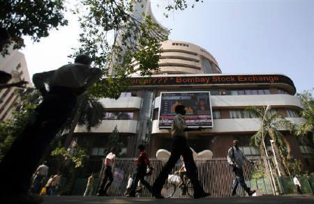People walk past the Bombay Stock Exchange (BSE) building in Mumbai January 9, 2009. The government has exempted state-owned firms from new rules requiring companies to have a public float of at least 25 percent, following two major share sales from government-owned firms earlier in the year that drew tepid responses. REUTERS/Punit Paranjpe/Files