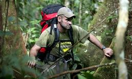 "<p>Ed Stafford of Leicestershire, England walks in between trees as he walks through the Amazon jungle in Brazil in this undated handout photo. Former British army captain Stafford became on Monday the first known person to walk from the origin of the Amazon river, the world's second-longest river, to its mouth, after withstanding ""50,000"" mosquito bites, scorpion attacks and skin disease in his 859 day odyssey. REUTERS/Handout</p>"