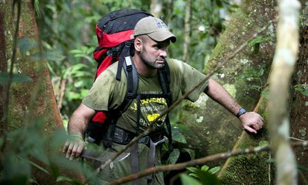 Ed Stafford of Leicestershire, England walks in between trees as he walks through the Amazon jungle in Brazil in this undated handout photo. Former British army captain Stafford became on Monday the first known person to walk from the origin of the Amazon river, the world's second-longest river, to its mouth, after withstanding ''50,000'' mosquito bites, scorpion attacks and skin disease in his 859 day odyssey. REUTERS/Handout