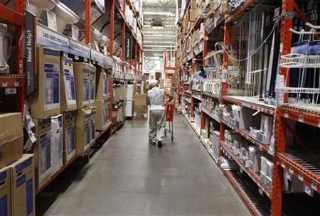 A man pushes his shopping cart down an aisle at a Home Depot store in New York, July 29, 2010. REUTERS/Shannon Stapleton