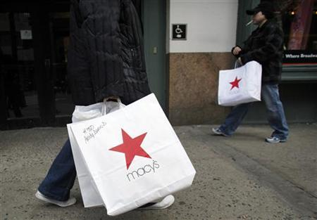 Shoppers carry shopping bags, after buying goods at Macy's flagship department store in Herald Square in New York in this March 2, 2010 file photo. REUTERS/Natalie Behring