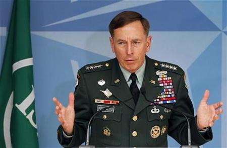 U.S. General David Petraeus, newly appointed U.S. and NATO forces commander in Afghanistan, answers questions during a joint news conference with NATO Secretary General Anders Fogh Rasmussen (unseen) at the Alliance headquarters in Brussels July 1, 2010. REUTERS/Thierry Roge