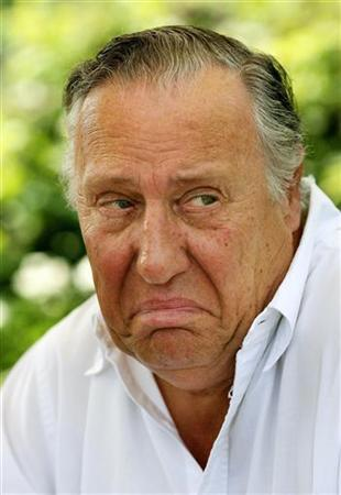 British novelist Frederick Forsyth makes a face during an interview with Reuters at his home near Hertford, England, July 26, 2006. REUTERS/Kieran Doherty