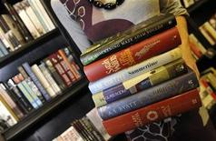 <p>An employee holds books as she poses for photographers in a bookshop in London October 5, 2009. REUTERS/Toby Melville</p>