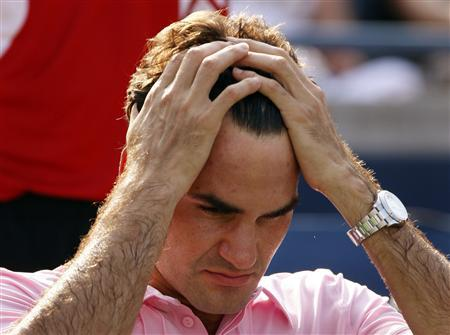 Roger Federer of Switzerland reacts after losing to Andy Murray of Britain during their final match at the Rogers Cup tennis tournament in Toronto August 15, 2010. REUTERS/Mike Cassese