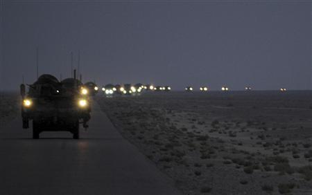 A line of Strykers convoy in the early hours of August 16, 2010 as part of the 4th Stryker Brigade Combat Team, 2nd Infantry Division, United States Division-Center's last patrol through Iraq as they leave for Kuwait. REUTERS/U.S. Army/Sgt. Kimberly Johnson/Handout