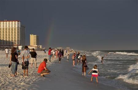 Beachgoers use Pensacola Beach, Florida after a storm June 4, 2010. REUTERS/Colin Hackley