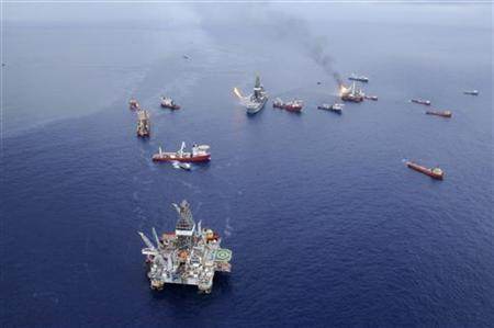 Crews aboard vessels around the drillship Discoverer Enterprise continue operations to minimize the impact from the BP Deepwater Horizon oil spill in the Gulf of Mexico in this June 28, 2010 handout photograph. REUTERS/Walter Shinn/U.S. Coast Guard/Handout