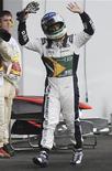 <p>Rubens Barrichello não teve sorte no domingo, naquela que seria sua corrida número 300 na Fórmula 1, já que saiu logo após a primeira volta, depois que seu carro da Williams bateu contra a Ferrari de Fernando Alonso. REUTERS/Fred Dufour</p>