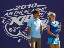 <p>Roger Federer of Switzerland and Kim Clijsters of Belgium appear at the Arthur Ashe Kids Day at the U.S. Open tennis tournament in New York, August 28, 2010. REUTERS/Brendan McDermid</p>