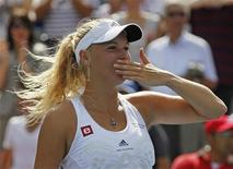 <p>Caroline Wozniacki of Denmark celebrates after defeating Vera Zvonareva of Russia in the rain delayed final at the Rogers Cup tennis tournament in Montreal, August 23, 2010. REUTERS/Shaun Best</p>