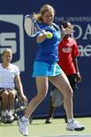<p>Kim Clijsters of Belgium hits a shot at a target in a skills competition during the Arthur Ashe Kids Day at the U.S. Open tennis tournament in New York, August 28, 2010. REUTERS/Brendan McDermid</p>