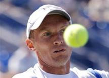 <p>Nikolay Davydenko of Russia eyes a return to Michael Russell of the U.S. during the U.S. Open in New York August 30, 2010. REUTERS/Eduardo Munoz</p>